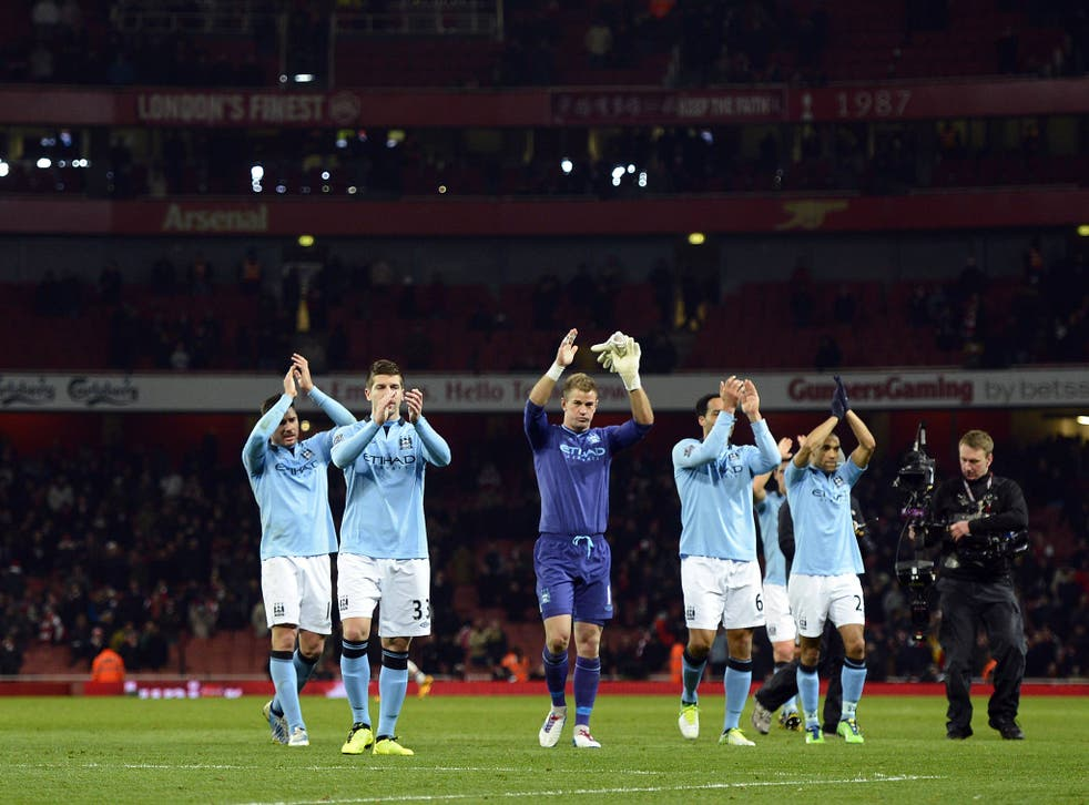 Manchester City players acknowledge their fans at Arsenal